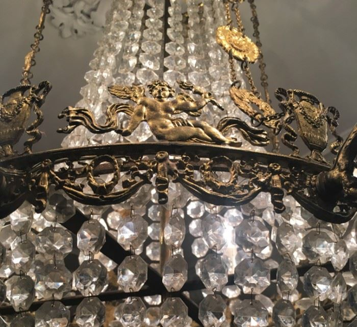 Gilt Metal and Crystal French Empire Chandelier Featuring Cherubs and Urns