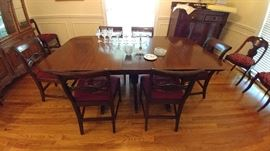 Beautiful dining table with two leaves and eight needlepoint chairs