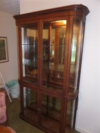 another lighted bowfront display cabinet