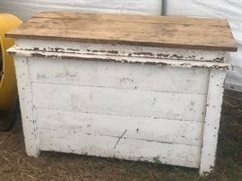 Primitive grain bin with hinged top and sections inside