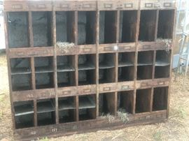 Antique cubby with old label holders, interesting galvanized shelves and back