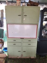 Vintage metal kitchen cupboard with drop down enamel top