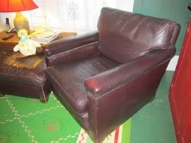 Pair of leather chairs and ottoman