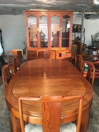 This is a Rosewood Dining room table and cabinet, this entire set was Custom made in Hong Kong. High quality like this is hard to find.