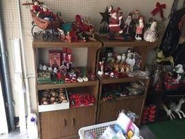 Vintage Christmas decorations- Santa, sleighs, snowmen, angels, reindeer, ornaments, etc.                             2 microwave storage carts on wheels.