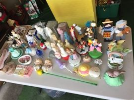 Avon decorative perfume bottles, Murano glass flower, music boxes, porcelain angel faces.