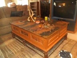 Copper top coffee table with iron base and drawers on all sides