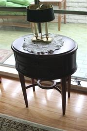 Oval end table with drawers.