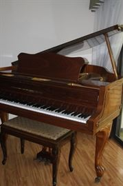 Zimmermann baby grand piano and bench.