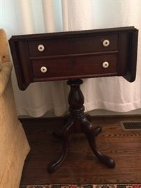 Early drop leaf sewing table with milk glass knobs
