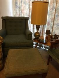 Matching chair and ottoman, groovy lamp.  Side table matches coffee table.
