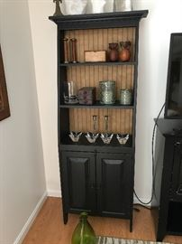 black hutch with décor items
