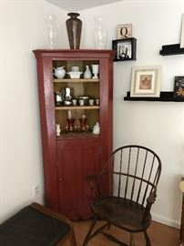 Corner cabinet painted red, Windsor chair, lots of pretty decor