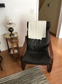 Ikea chair with ottoman, side table, antique lamp