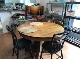 Oak table, antique chairs, more décor, and kitchen items