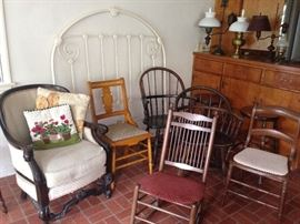 Old iron bed frame. Many antique chairs. Great old table lamps.