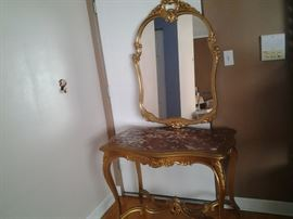 French table and mirror(needs new paint and new marble top). $ 250
