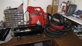 Air compressor, Master Blaster, shop vacuum, parts bin and more.