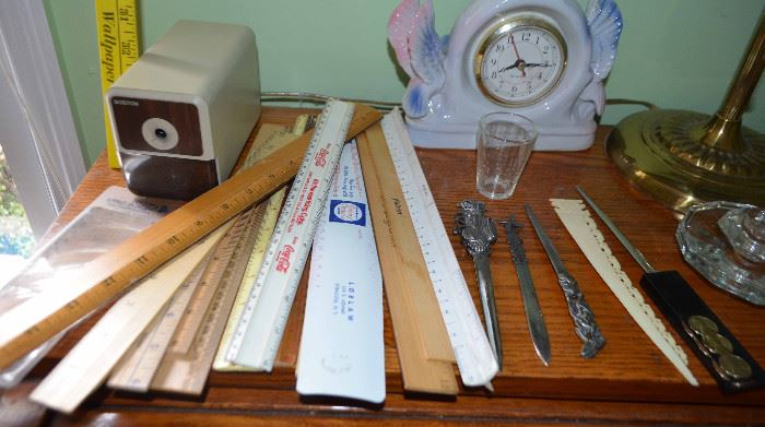 vintage rulers with various logos; letter openers; electric pencil sharpener