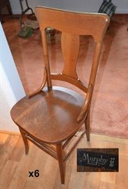 6 oak chairs marked Murphy Incorporated,Owensboro KY 136. To be sold with pub table.