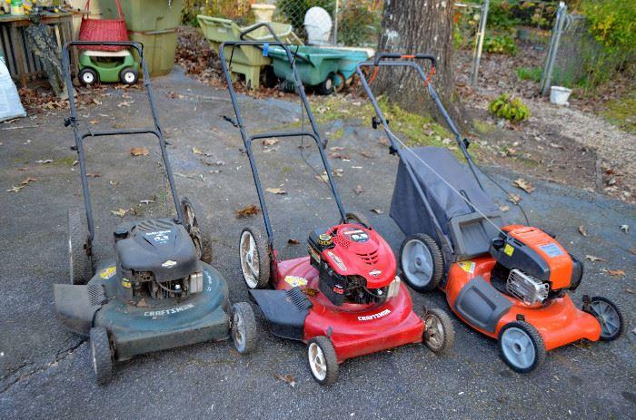 three lawn mowers!