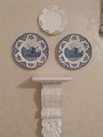 There's a collection of blue/white plates on the wall.