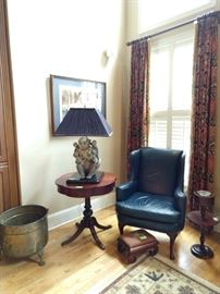 "Before you ask, yes, all window treatments are for sale, none of the crappy light fixtures, but ALL window treatments.  Nice blue leather wingback armchair, 1940's vintage scalloped drum table, antique needlepointed footstool, vintage mahogany smoking stand, big ol' brass planter with hairy paws and last, but certainly not least, the ""Lady Madonna"" porcelain monkey table lamp!"