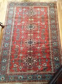 "Vintage hand woven Persian Viss rug, 100% wool face, measures 4' 8"" x 7'."