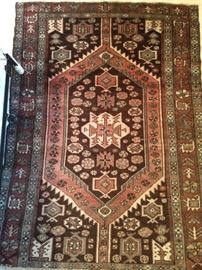 "Vintage hand woven Persian Viss rug, 100% wool face, measures 4' 4"" x 6'."