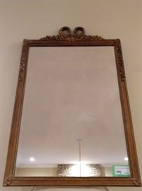 Vintage Hand carved gold gilt Frenchy mirror, with bow on top.