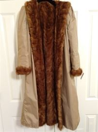 Here's something you won't see very often - a reversible, mink-lined raincoat - LOVE IT!                                                     It's also a size 8, so don't be late!
