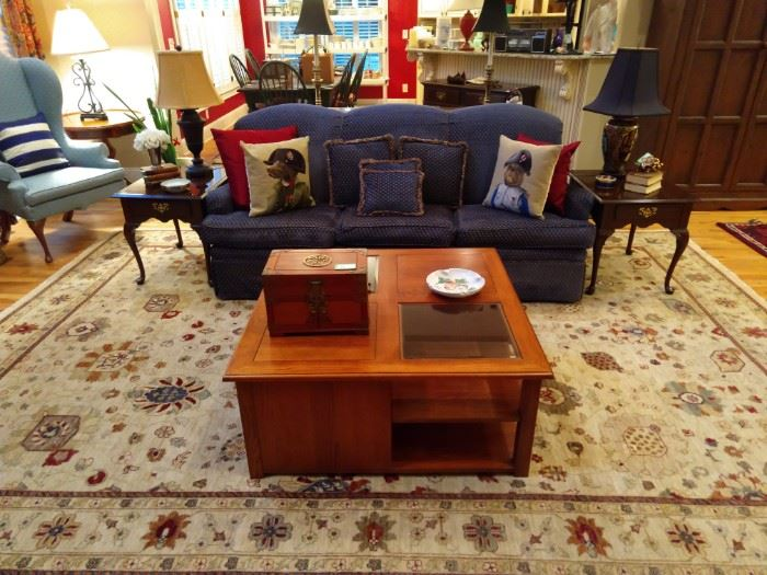 "Lovely hand woven Oushak design rug, measures 11' 4"" x 14' 3"", Ethan Allen wood/beveled glass coffee table, newly upholstered sofa, pair of vintage mahogany Ethan Allen end tables, with unmatched pair of table lamps."