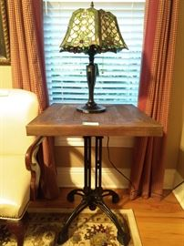 One of a pair of vintage side tables, with cast iron bases and reclaimed wood tops.                                                             See? There's more of those stained glass lamps!