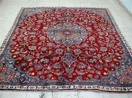 "Vintage hand woven Persian Mashad rug, 100% wool face, measures 8' 6"" x 7' 6""."