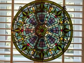 Very pretty round stained glass window in the breakfast room.