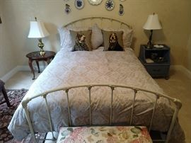 Queen size vintage iron bed, with relatively unused mattresses.