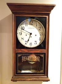 "Tick Tock, it's time to attend another one of our fabby estate sales! Oh, wait, I'm just talking about this lovely Hamilton ""Regulator"" 8-day chiming wall clock. It's not the best looking clock you'll see, but the lilting chimes have been a delight as we've set up this house. It's OK, I can let it go at the sale.                                                               Really, it's for sale!"