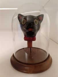 "Nothing to see here folks, just a vintage terra cotta cat head under glass.                                                                                You can buy this for your huzzbin and tell him that you're having that famous French dish for dinner ""Chatte sous verre"" or""Puss Under Glass"".                                                         It's the other white meat!"