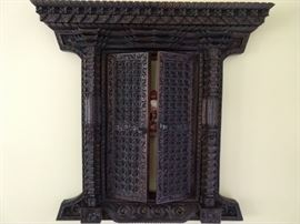 Hand carved wood, wall hung Balinese temple door.