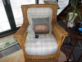Pair of wicker easy chairs with cushions