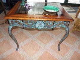 Verdigris base/glass top table