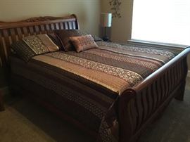 Queen size bed - headboard, footboard, mattress, box spring and bedding
