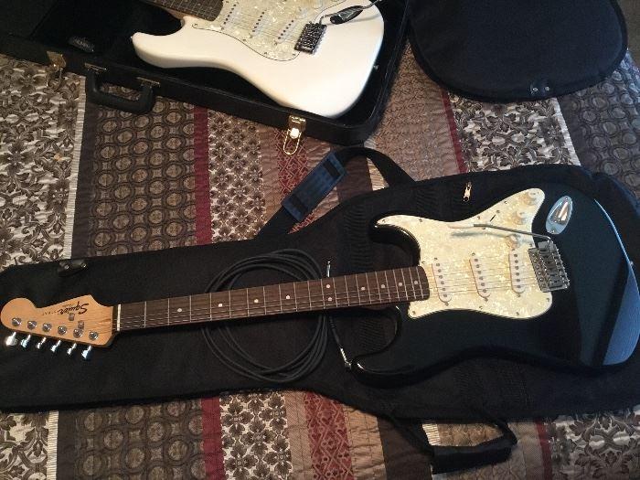 Black and white Fender Squier Strat in soft Fender carry case