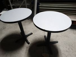2 small round pedestal base cocktail tables
