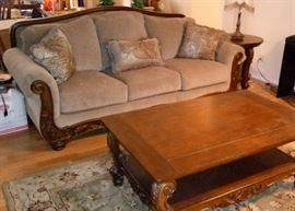Cecilyn Mocha beautiful mahogany stained carved wood embellishments on seating pieces with matching heavier wood tables. Fabric is a taupe/brown no stains, no wear and wood is almost perfect condition no breaks, no dings and very few light surface scratches.  6 pieces Sofa, Love Seat, Coffee Table, 2- round End Tables and Sofa Table includes 5 accent pillows $1100 cash or debit/credit (card and card owner must be present to swipe and sign.