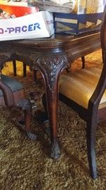 Antique dining table has a few chairs that need love
