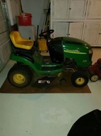 John Deere riding mower. Runs and works. Low hours.