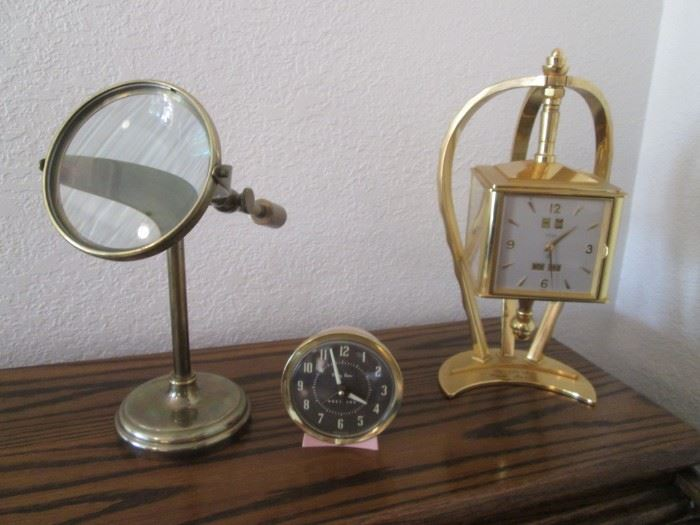 Baby Ben Clock by Westclox.                                                 Brass Clock on Revolving Stand, 15 Jewel, Barometer, Thermometer, Hygrometer.                                                               Old Magnifying Glass on Stand.