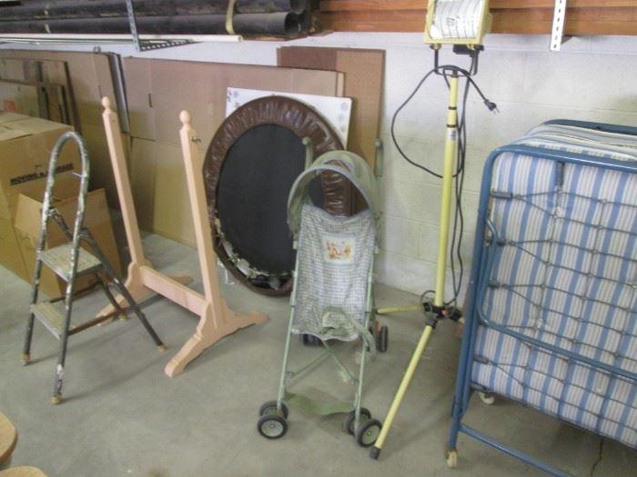 Work Light.  Small Trampoline.  Stroller
