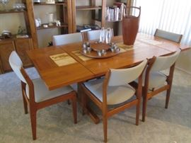 Danish Modern Teak Dining Room Table/6-Chairs with 2 Side Leaves.  Tile Insets down the center of the table.    Leaves drop down and pull out for function.